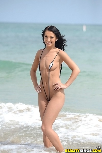 Undressing darling Kelly Diamond X is showing her body on a beach