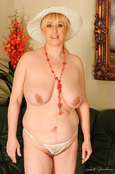 Fatty enormous titted aged drops her strings to smack her drenched muff