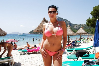 Beautiful Aletta Ocean standing outdoor on the beach in bikini