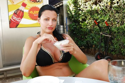 Beautiful Aletta Ocean standing outdoor on the beach in bikini