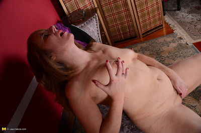 American housewife plays with her shaggy gentile