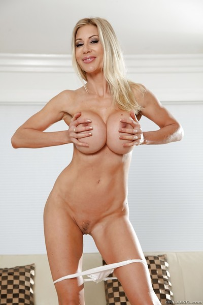 Curvy golden-haired bodybuilder Puma Swede posing in sports brassiere and yoga g-string