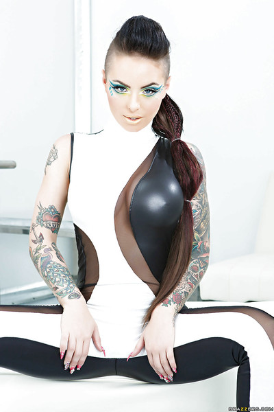 Enjoyable tattooed vixen slipping off her glam clothing and sexy pants