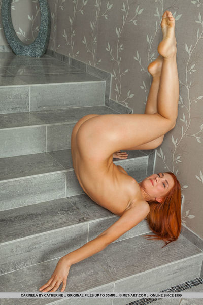 Redheaded juvenile beauty displaying hot butt and alluring legs for glamour images