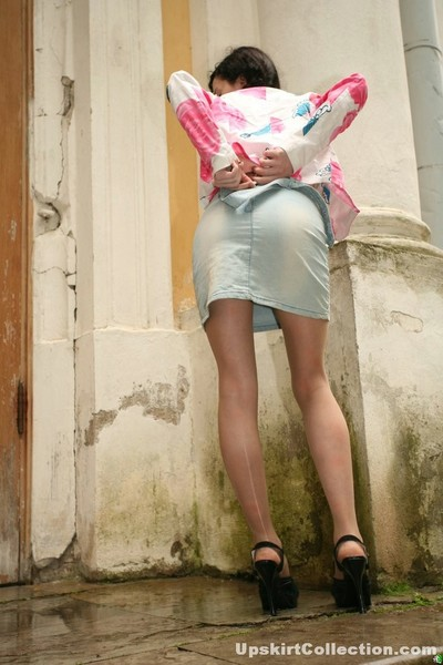 Angel in rigid jeans petticoat bares milk cans and shows useful wastes