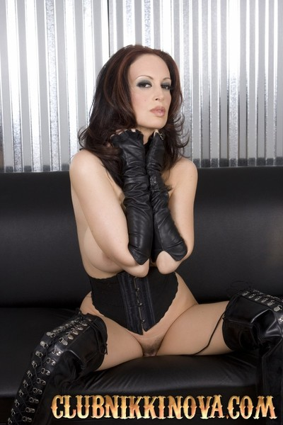 Dark brown bombshell, Nikki Nova, attains dirty in her appealing gentile high boots and leather corset showing off her elegant titties and fabulous pussy!