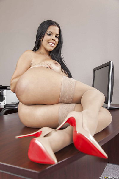 Titty secretary Diamond Kitty is posing stripped on the working table