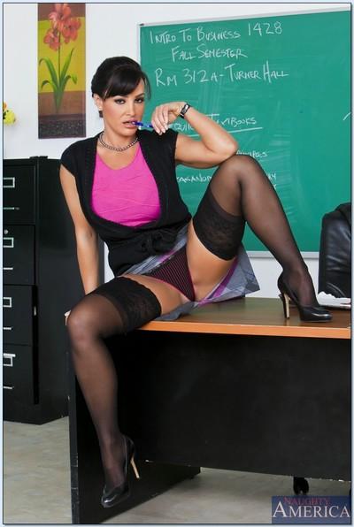 Clammy educator Lisa Ann brings out her MILF billibongs and posing in