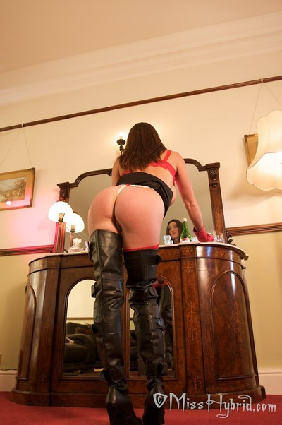 Waste high boots and red leather gloves