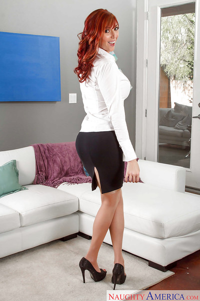 Redhead unclothed case Lauren Phillips posing entirely dressed in petticoat and heels