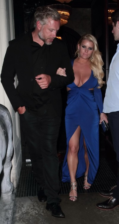 Jessica simpson rounded and leggy in blue plunging costume