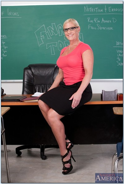 Lusty seasoned mentor Amber Irons showing her large meatballs in high heels.