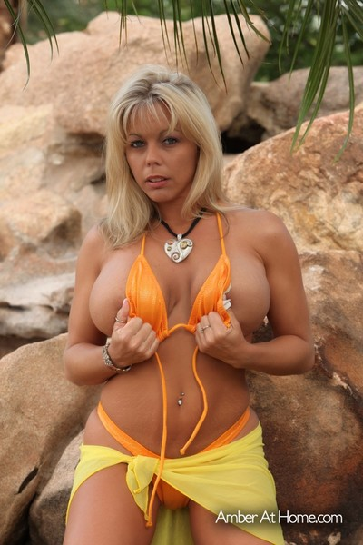 Amber Lynn Bach shows off her spectacular body in a hot bikini then removes clothes it off.