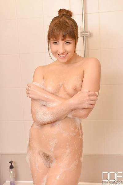 Sexual European juvenile amplifies her drenched furry vagina despite the fact pleasing a shower-room