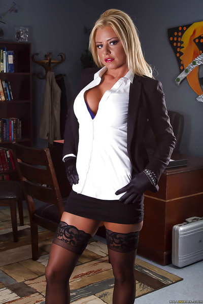Working blond Britney Shannon demonstrates her major love muffins in office
