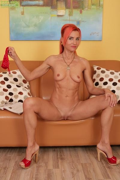 Slight grown doll Klarisa Damp takes off her pretty costume on webcam