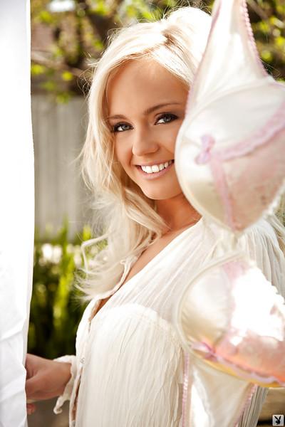 Seductive blond coed Brandi Lynn posing just dressed outdoor