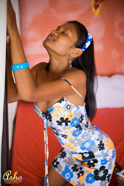 Asha Kumara haphazardly shows her teat in a sundress