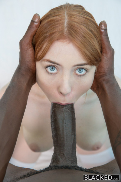 Red head gal admires ebon phallus