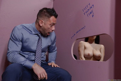 Young pretty Noelle Easton and her gigantic naturals spend time at the gloryhole