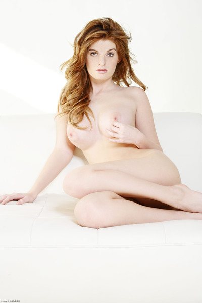 Attractive pale redhead uncovered