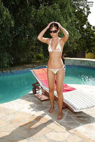 Skinny 19 darling slipping off her bikini and fingering her muff by the pool