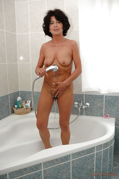 Seductive brunette hair established striptease off her sexy pants and attractive a shower-room