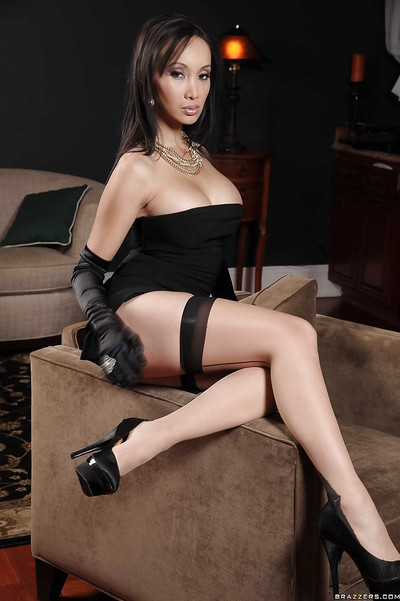 Eastern MILF takes off her suit to unveil her magnificent body in nylons