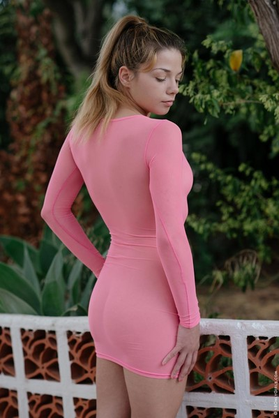 Hawt toned sweetheart wearing a pink sheer suit