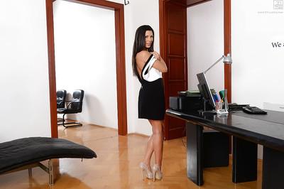 Leggy brunette hair solo exhibit Alexa Tomas posing topless in petticoat and heels