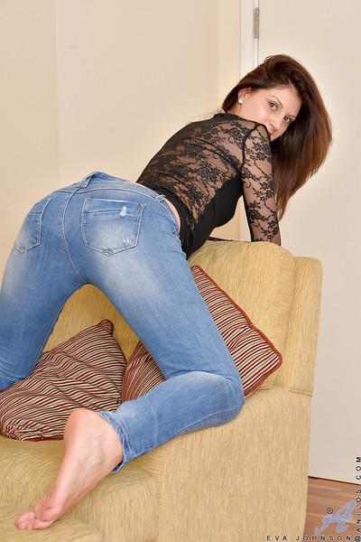 Granny dame Eva Johnson posing solo in butt hugging denim jeans