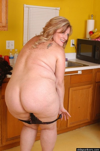 SSBBW Blond with overweight body Deedra is undressing and then posing