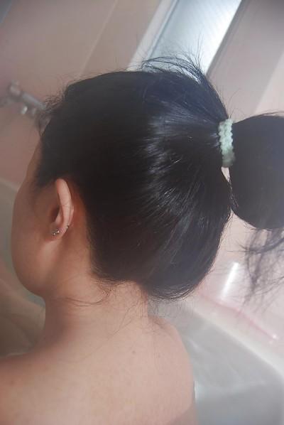 Oriental babe with a wavy love-cage Kanae Hiyama takes a sweaty baths