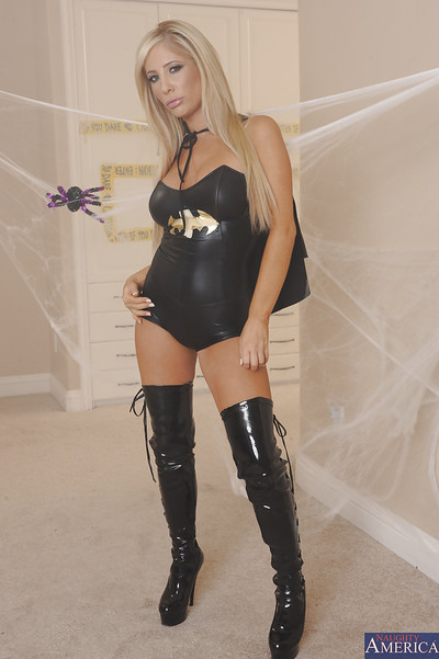 Fascinating fairy-haired in wild batgirl outfit undressing and fingering her uterus
