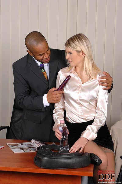 Nice-looking golden-haired in nylons enjoys rough interracial sexual act in the office