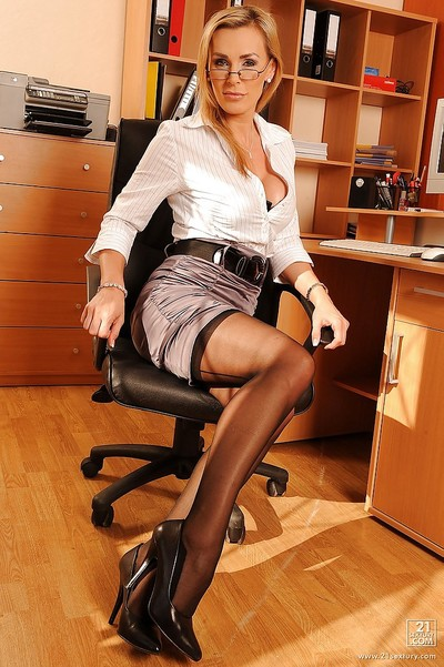 Seductive MILF Tanya Tate posing as a passionate office secretary