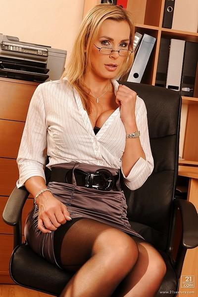 Seductive MILF Tanya Tate posing as a passionate office secretary