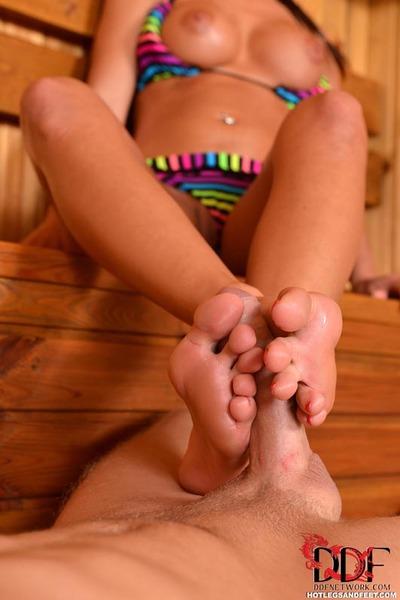 Leggy hottie Nicole Vice jerking biggest shlong with stripped feet in sauna