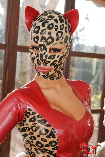 Moist kink hottie in latex outfit Ebony Angelica revealing her marvelous cage of love