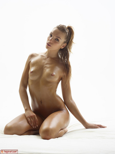 Spectacular domme amber positions unclothed to flaunt her watertight body