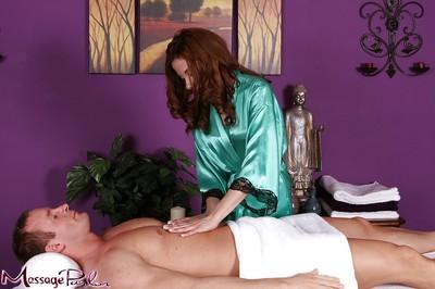 Redhead massage therapist Evelyn Fierce taking in shlong in 69 position