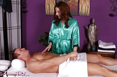 Redhead massage therapist Evelyn Fierce taking in shlong in 69 position