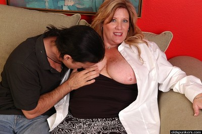 Freckled BBW Deedra sets free large hooters for boob button licking act