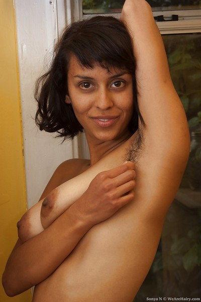 Perspired indian queen Sonya N exposing her curly armpits and curly slit