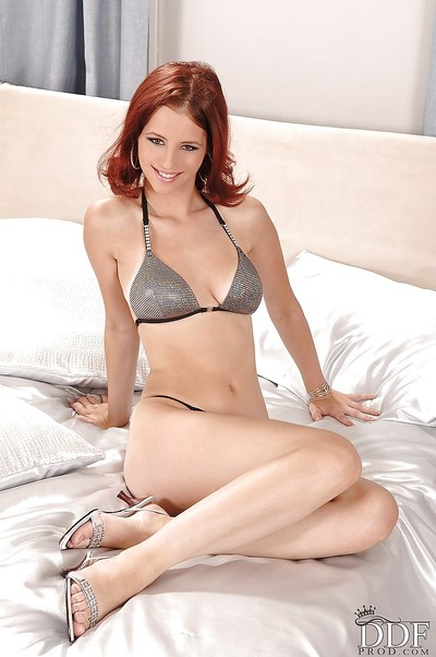 Desirable redhead slipping off her underware and expanding her clits