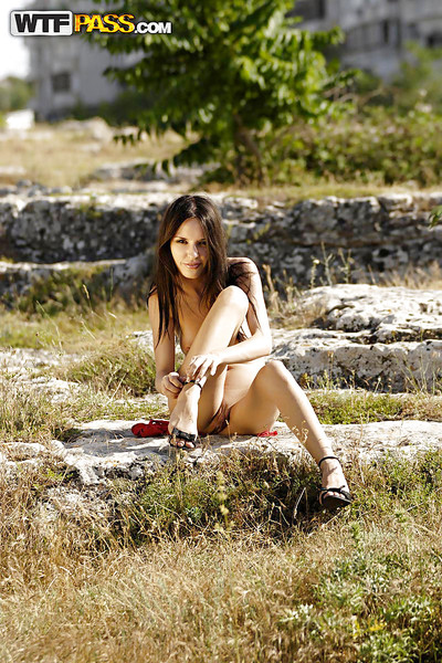 Leggy brown hair teen on high heels revealing her appealing body outdoor