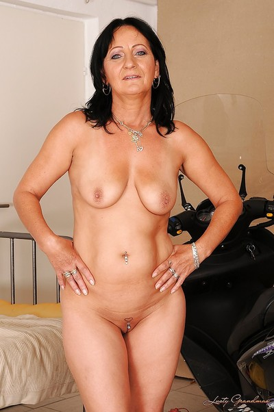 Dark brown full-grown with large limber mambos glorious off her costume and strings