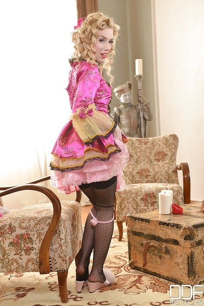 Blond beauty Nesty posing solo in vintage underware and