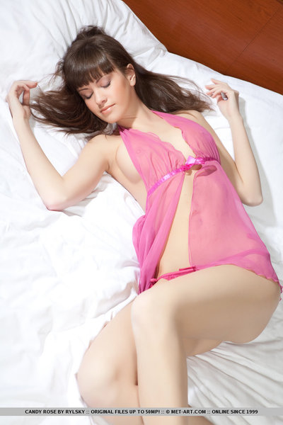 Candy Rose is have a fun an enticing eye candy as this chick lie on the tasteful white bed, clothes in bright pink lingerie, and with a bright, appealing smile on her spectacular face.