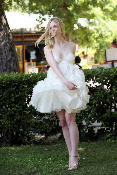 Elle fanning cleavy and leggy in white lace costume